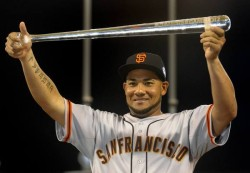 National League All-Star Cabrera of the San Francisco Giants holds the MVP trophy in Kansas City