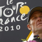 Radioshack team rider Armstrong of the U.S. poses on the podium of the 20th stage of the 97th Tour de France cycling race between Longjumeau and Paris
